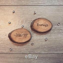 Rustic engraved wooden name places log slices wedding table decor name places